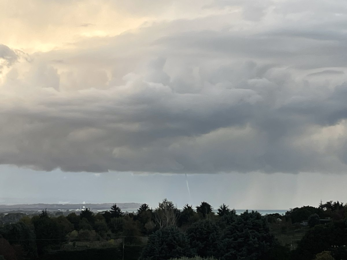 Water spout and lightning off the coast from Napier