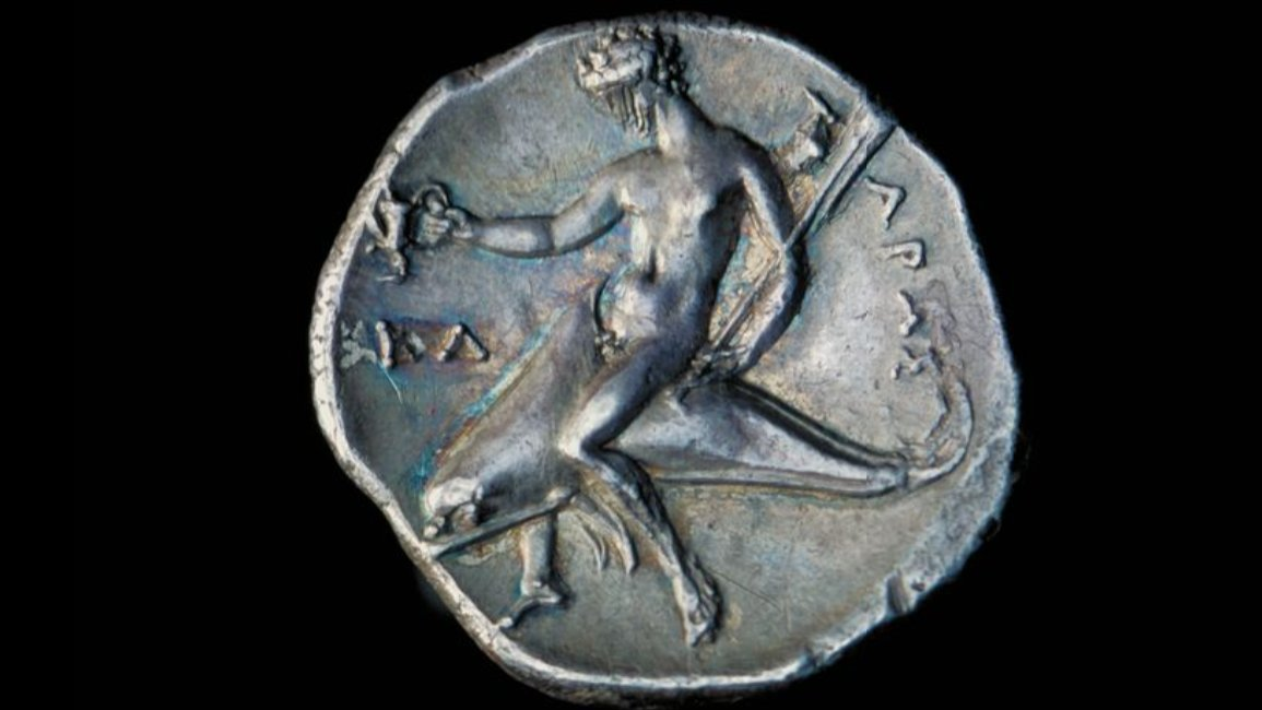 Happy #NationalDolphinDay Taras, a marine deity, said by Aristotle to be the son of Poseidon, is represented riding on a dolphin and holding Kantharos which is a type of ancient Greek cup used for drinking. Happy #NationalBeerDay Coin ABDUA:49013 from @uoacollections https://t.co/dxB8CRppWU