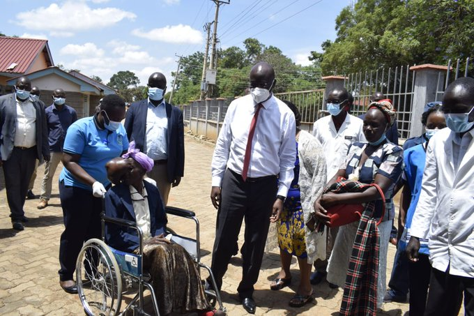 Bungoma Governor Wangamati (centre) picks Mama Beatrice Makokha from her Kamusinde home in Kimilili Sub County and for medication at Bungoma County Referral Hospital.