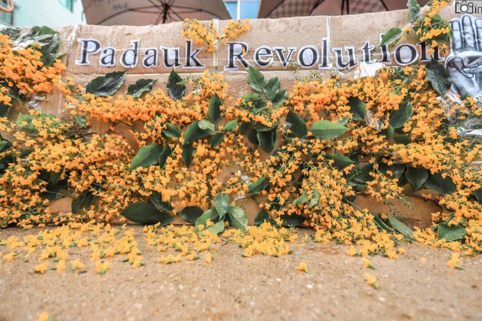 """Anti-coup protesters launched the """"Padauk Revolution"""" in Yangon on Monday. The yellow flower locally called """"padauk"""" is one of the primary symbols of Myanmar's New Year water festival. #WhatsHappeningInMyanmar https://t.co/E04pdLoydh https://t.co/TWdXifXiCz"""