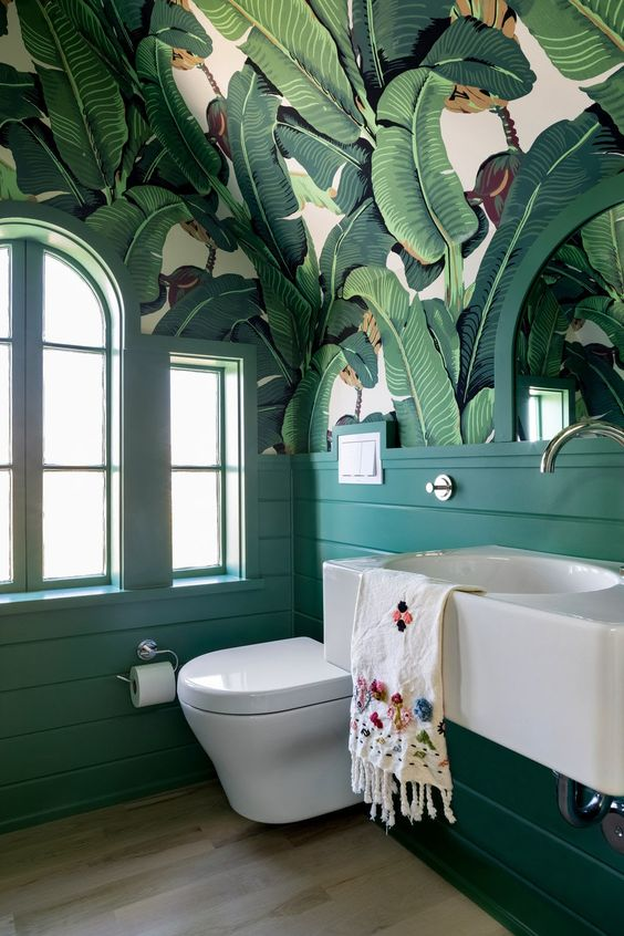 This green art deco #bathroom wallpaper is our #styleoftheweek. Bring a whimsical touch to your bathroom and click the link in our bio to get an instant bathroom estimate hubs.ly/H0KFvC90