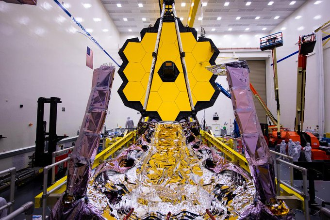 James Webb Space Telescope in facility with primary mirror deployed and sunshield folded