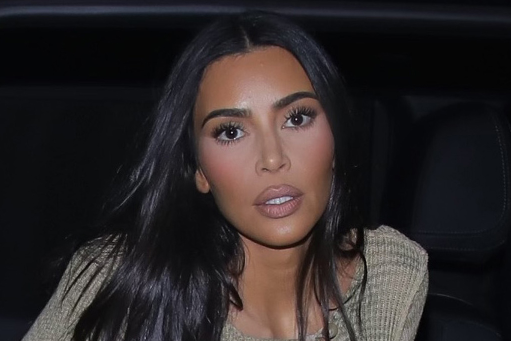 Kim Kardashian Debuts Her Billionaire Style in a Peek-a-Boo Cutout Top, High-Rise Jeans & Soft Booties Photo