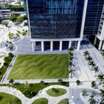 """The artist Maya Lin built up rising mounds of soil and grass in 2005 to make """"Flutter."""" This resulting earthwork creates the mesmerizing effect of rippling waves outside the Wilkie D. Ferguson, Jr. U.S. Courthouse in Miami, managed by GSA. https://t.co/ABFAXXnXSe  #EarthDay"""