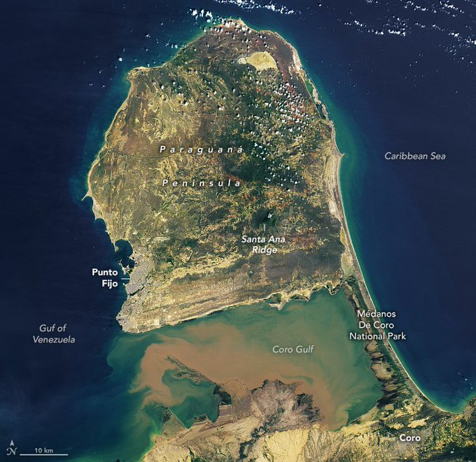 The image above was acquired on October 18, 2020, by the Operational Land Imager (OLI) on the Landsat 8 satellite. A sliver of green lines the highest points in the center of the peninsula: the Santa Ana Ridge rises up to 830 meters (2,700 feet) above sea level. Thorny plants live at lower elevations, while deciduous forests and woody plants grow at higher elevations. The area was designated the Cerro Santa Ana Natural Monument in 1972.
