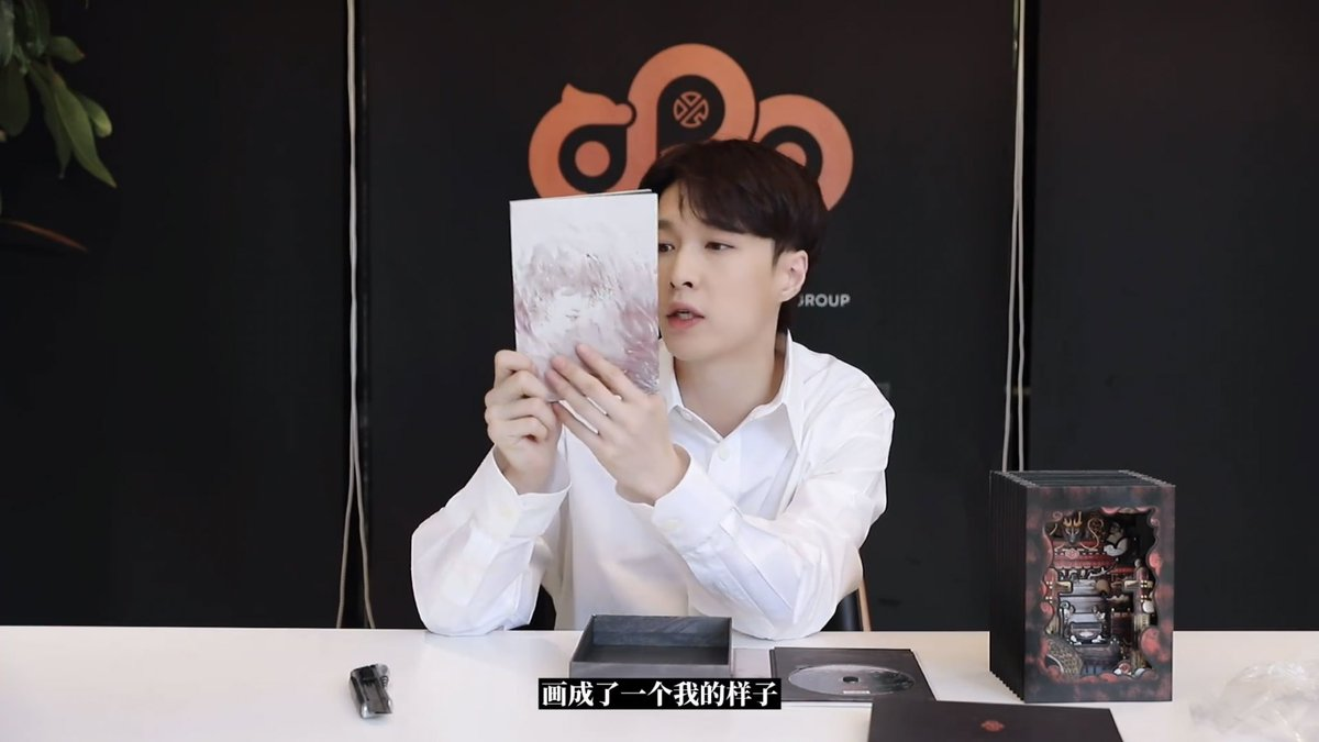 yixing posted an unboxing video of lit physical album 😭