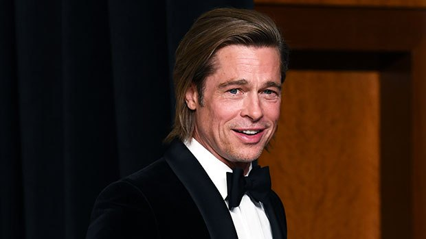 Brad Pitt is pushed in a wheelchair after having his wisdom teeth removed in Beverly Hills Photo