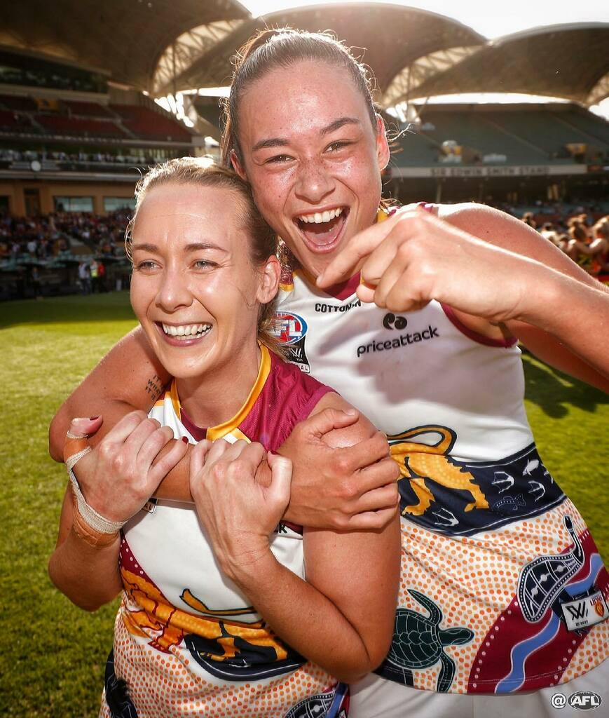Lauren Arnell and Jesse Wardlaw celebrate the Lions historic victory #AFLWGF https://t.co/0lBrLmlE2P.