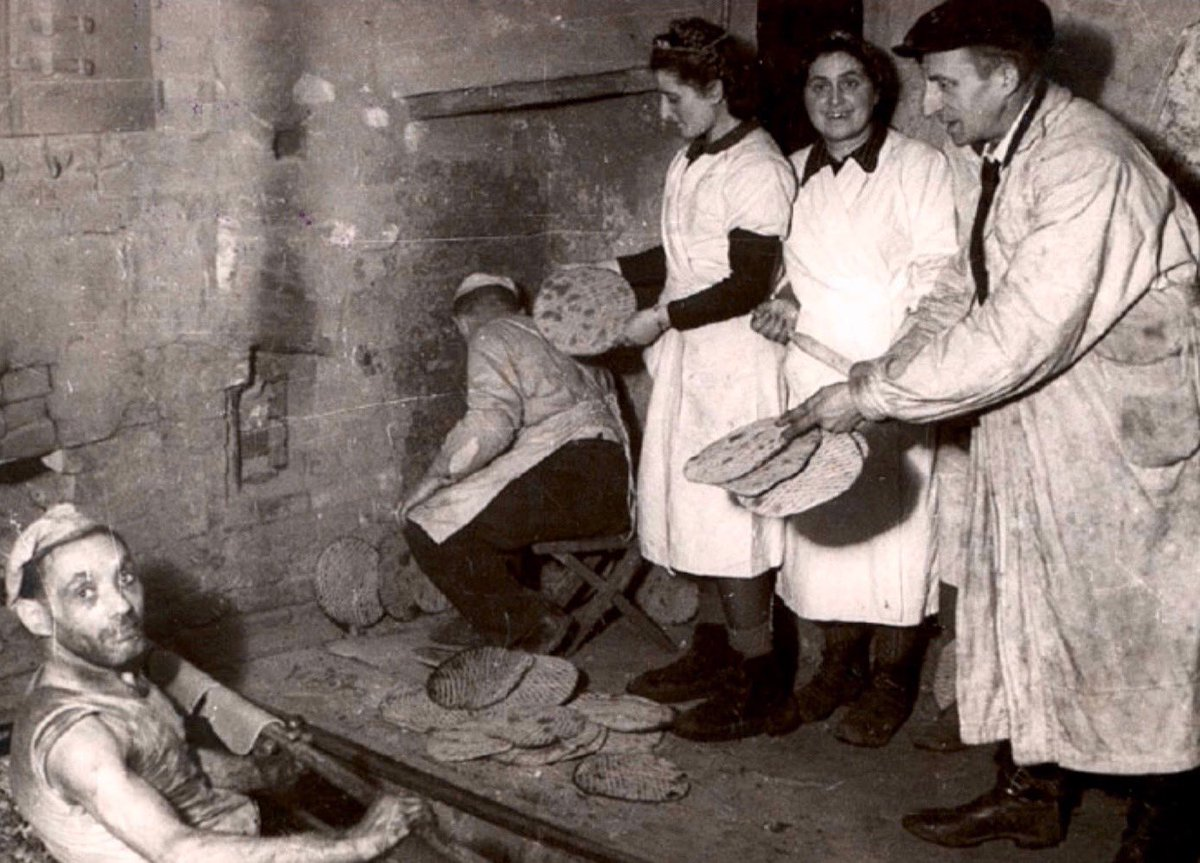 In the Łódź ghetto, German-occupied Poland, captive Jews bake matzo bread to celebrate the festival of Passover: in secret, using flour carefully hoarded over starving weeks. A German army waits in the city, ready to empty the ghetto & send its inhabitants to their deaths. https://t.co/WGTlb3DXSx
