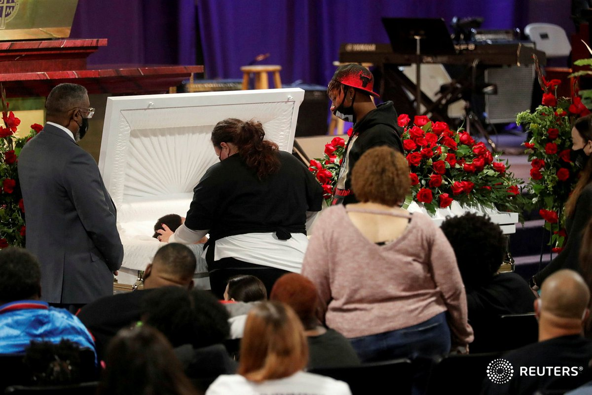 Katie Wright, the mother of Daunte Wright touches her son in a casket during a viewing service, after he was shot and killed by Brooklyn Center Police officer Kim Potter, at his public viewing at Shiloh Temple International Ministries in Minneapolis. Photo by @OctavioJones