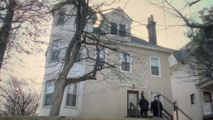 Sil and Christopher are outside the DiMaggio brothers home on Atwell Avenue.