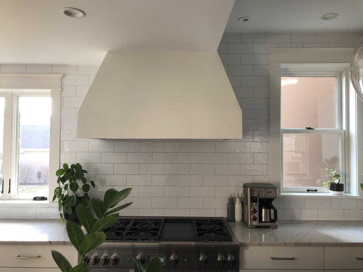 Kitchen backsplash- subway tile in offset pattern up to the ceiling. #denvertiles #experttouchtiling #backsplash #kitchendesign