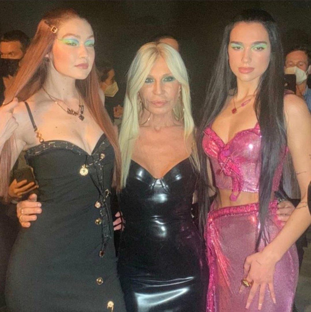 .@GigiHadid, Donatella Versace and @DuaLipa at the #VersaceSS22 show for Milan Fashion Week.