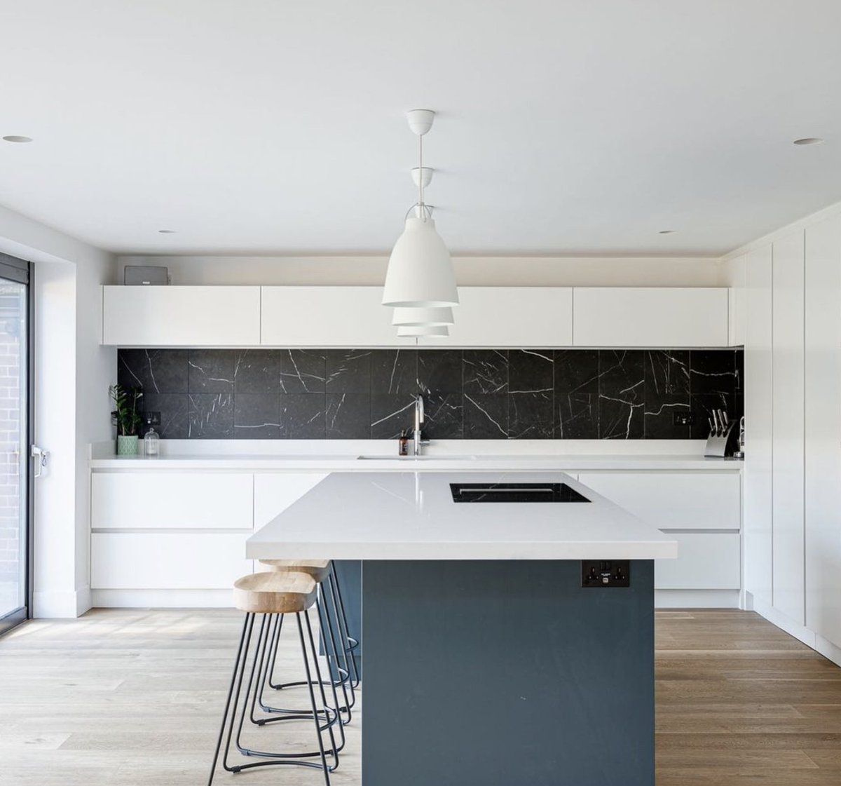 We love the sleek lines & contrasting colours in this striking kitchen by bit.ly/PlanetFurniture . The island offers a pop of Hague Blue by @FarrowandBall while the Silestone worktop by @CosentinoUK & Miele induction hob with integrated extraction keeps the design streamlined