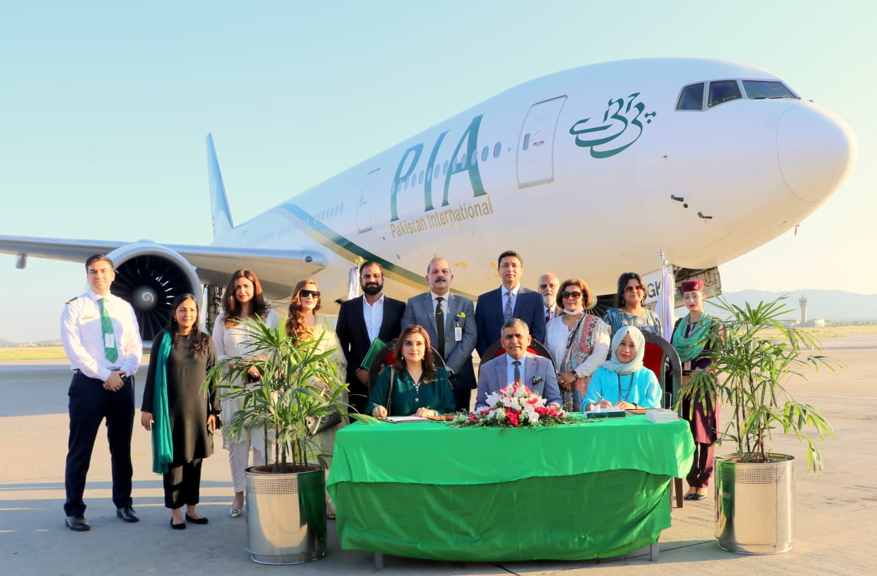 The signing of the MoU between PIA, UN Women, and FOSPAH at Islamabad International Airport (ISB) on Sunday. The Chief Executive Officer (CEO) of PIA, Air Marshal Arshad Malik, the country representative for UN Women, Sharmeela Rassool, and the FOSPAH, Kashmala Tariq, are also present.
