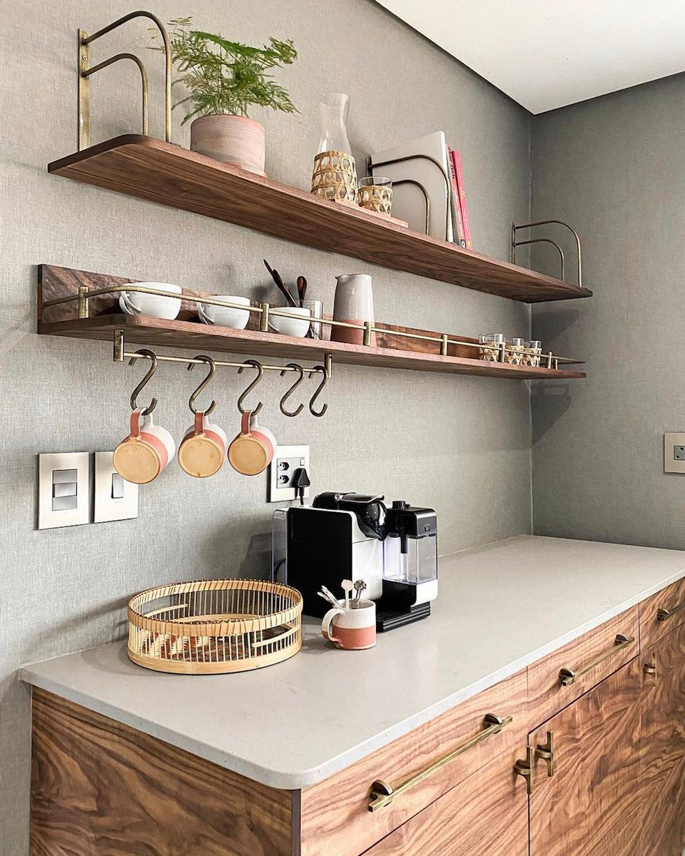 Sophisticated, yet demure, Sleek Concrete creates a strong, neutral base from which to add pops of colour to your design. Just like it does in this beautiful coffee station by Douglas & Douglas. bit.ly/SleekConcrete4… #caesarstonesa #sleekconcrete #interiordesign #coffeestation