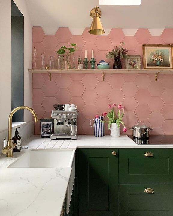 We're loving @adamsfamilyreno's pink & green kitchen with brass accents and open shelving! . . . . #regram #repost #loveyourspace #kitcheninspo #pinktiles #greencabinets #kitcheninspiration #housebeautiful #housebeautifuluk