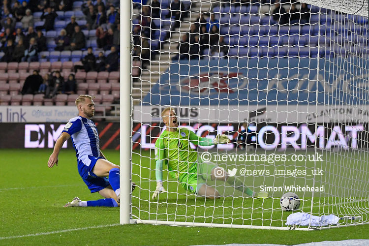 Ben Amos #12 of Wigan Athletic can do nothing to prevent Max Power #8 of Wigan Athletic (not pictured) from scoring an own goal to make it 0-1 @LaticsOfficial #Wigan @swfc #swfc @SkyBetLeagueOne #photography @SkimboydPics