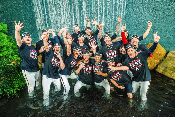 The Braves bullpen celebrates in the fountain at Truist Park.
