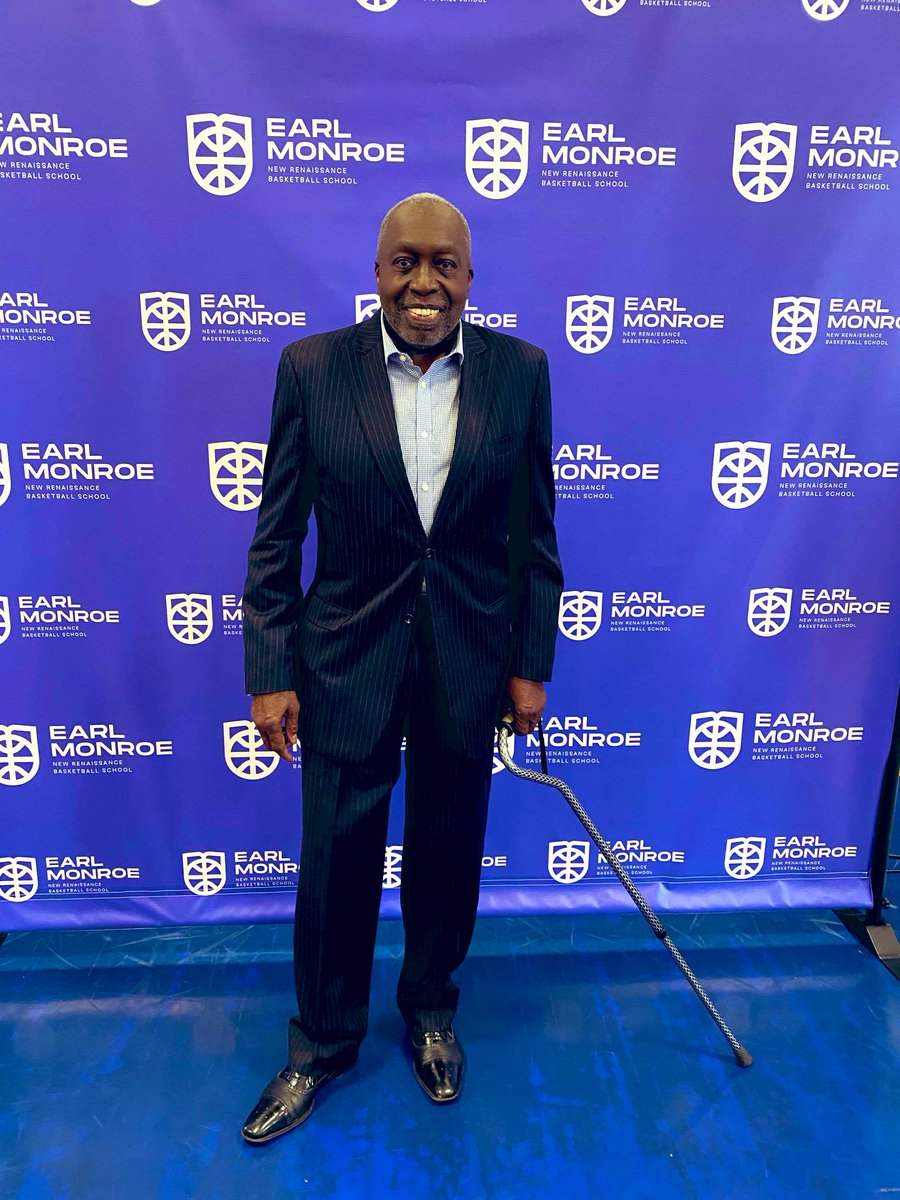 """Hall of Famer Earl """"The Pearl"""" Monroe  is all smiles at the Grand Opening and Ribbon Cutting of The Earl Monroe New Renaissance Basketball School."""