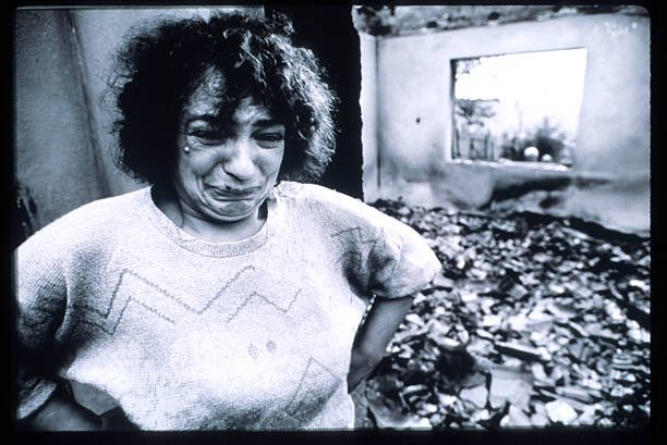 An ethnic Albanian woman cries after looking at the damage in her home resulting from Serb attacks October 1998 in Kosovo. 𝙿𝚑𝚘𝚝𝚘 & 𝙲𝚊𝚙𝚝𝚒𝚘𝚗 𝚋𝚢 𝚁𝚘𝚐𝚎𝚛 𝙻𝚎𝚖𝚘𝚢𝚗𝚎/𝙻𝚒𝚊𝚒𝚜𝚘𝚗