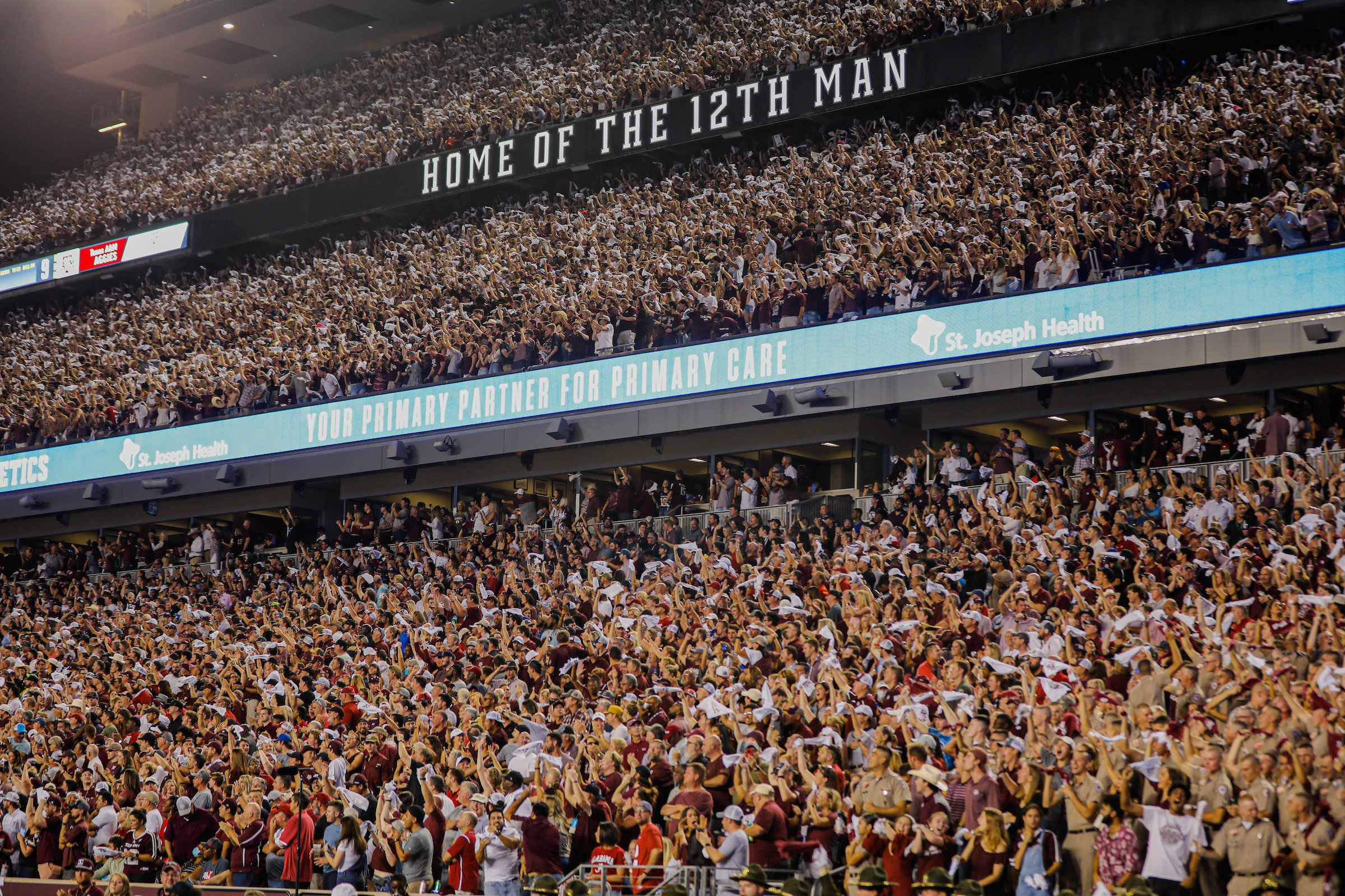 the student section in kyle field with home of 12th man sign