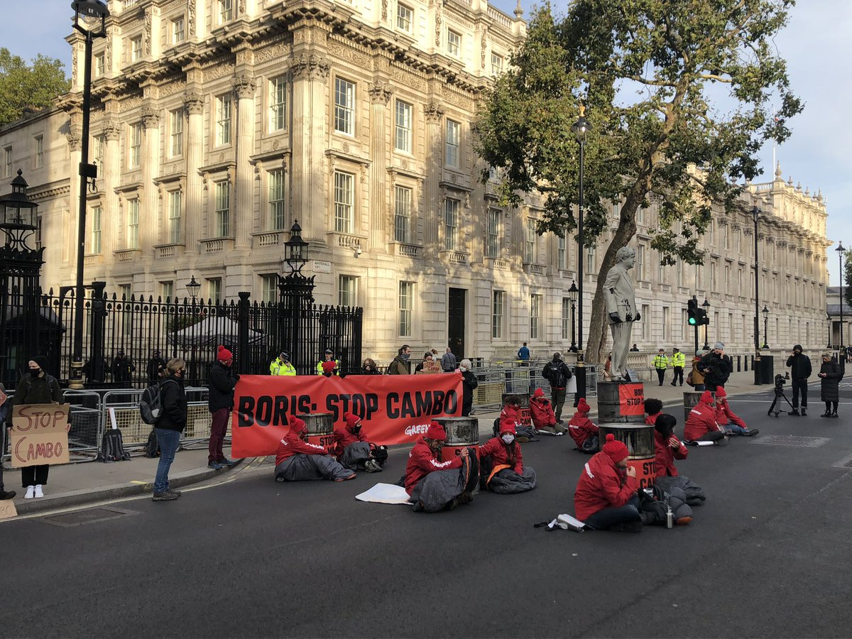 Whitehall reduced to one lane of traffic —a Greenpeace protest, including a mock statue of the Prime Minister and a sit in on the road outside Downing Street. It is in opposition to the development of the Cambo oilfield @BBCNews @BBCPolitics