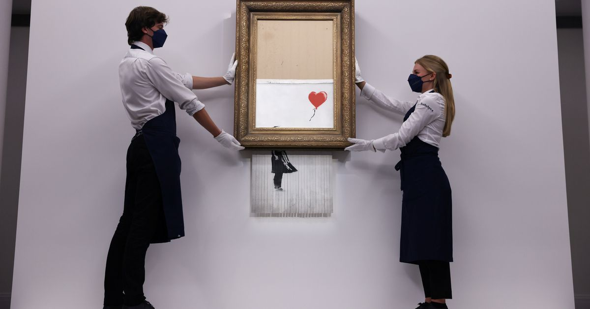Half-shredded Banksy fetches $25.4 mln on return to Sotheby's