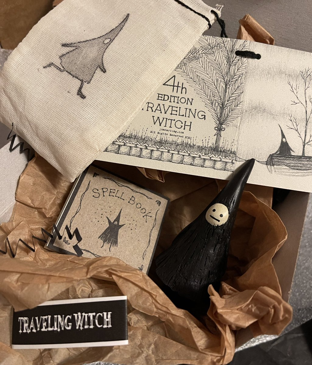 MAIL CALL! Received an awesome package from @JonCarling — my very own #TravelingWitch 🖤 The unboxing is a revelation — customized box, pin, paper goodies, stickers, Spell Book!, black shred and a tiny witch in a bag. 🧙🏿♀️