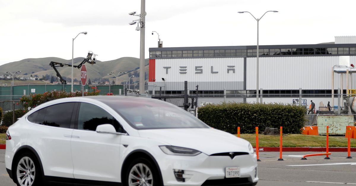 Tesla says new factories will need time to ramp up, posts record revenue