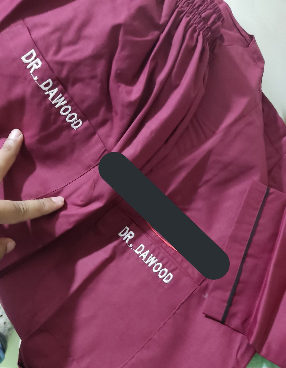 Why do our new hospital scrubs have names on the buttocks