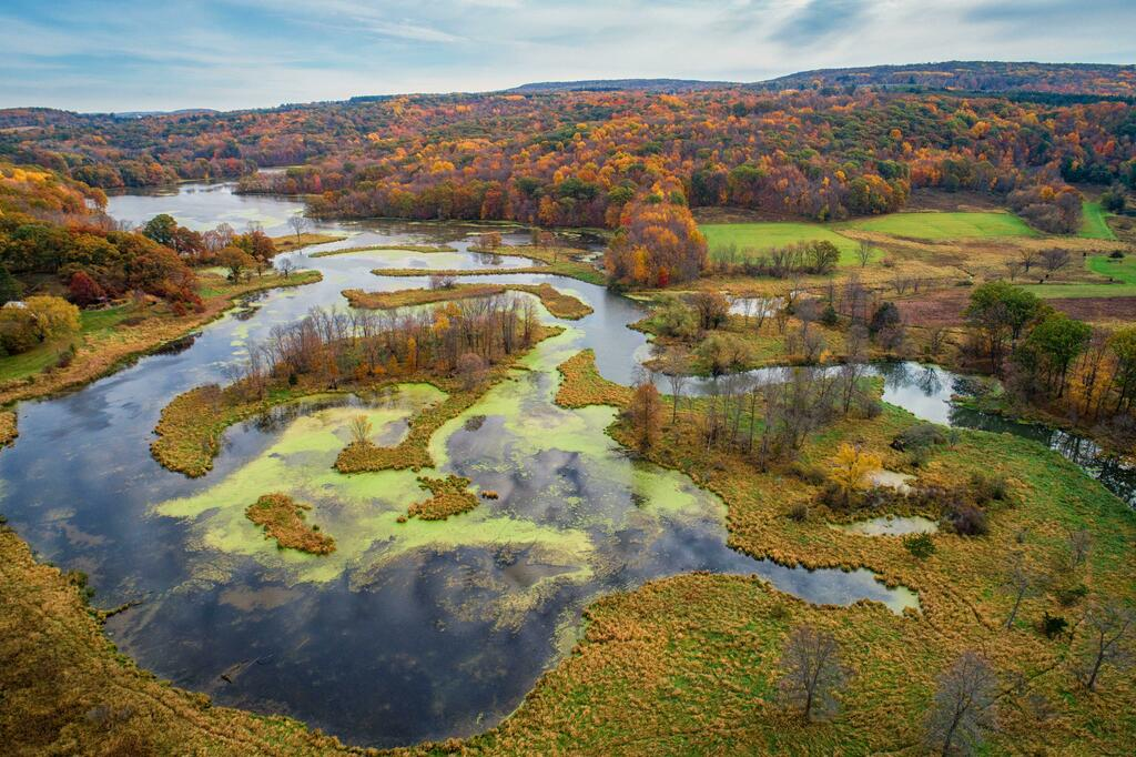 A sprawling marsh meets the rolling hills of the Driftless Area in Baraboo, Wisconsin [5464x3640][OC] 💰🌎 Submit your best CRAZY travel blogs/stories to madtravelling@yahoo.com to become part of our next book, Mad Travelling! 🏙🤑 #travel #traveljobs #blogger #travelblogger…