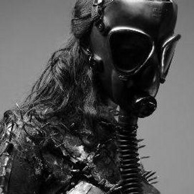Fetish in a gas mask