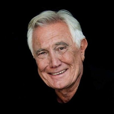 The 81-year old son of father (?) and mother(?) George Lazenby in 2021 photo. George Lazenby earned a  million dollar salary - leaving the net worth at  million in 2021