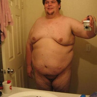 Fat man naked in bed