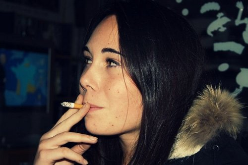 Alizée smoking a cigarette (or weed)