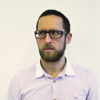 Image of Ben wearing glasses looking puzzled.