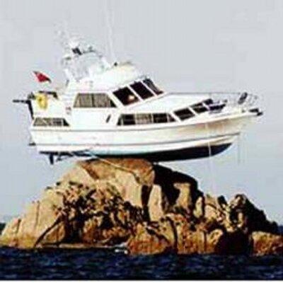 a boat on rocks