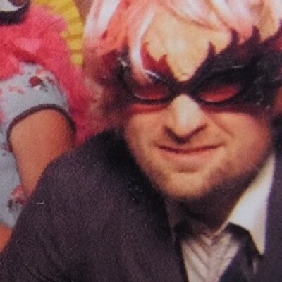 I'm wearing silly glasses and a pink wig, in a wedding photo booth thingy.