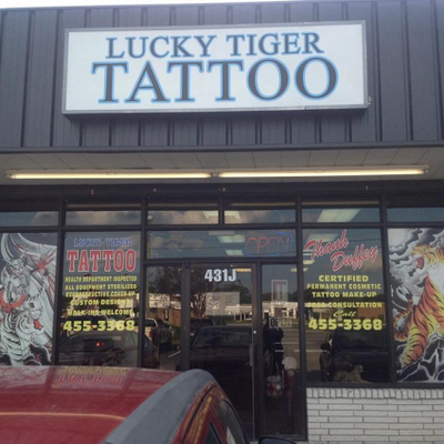 Lucky tiger tattoo tattoo lucky twitter for Jacksonville nc tattoo shops
