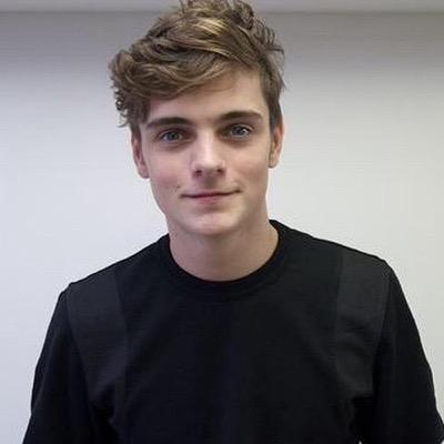 Martin Garrix  - 2018 Regular brown hair & alternative hair style.