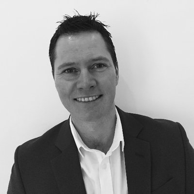 Black and white head shot of Paul Coombes