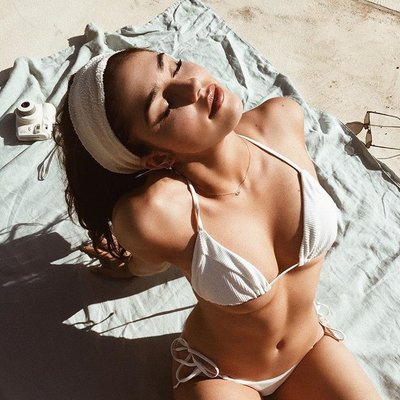 Shows off bikini