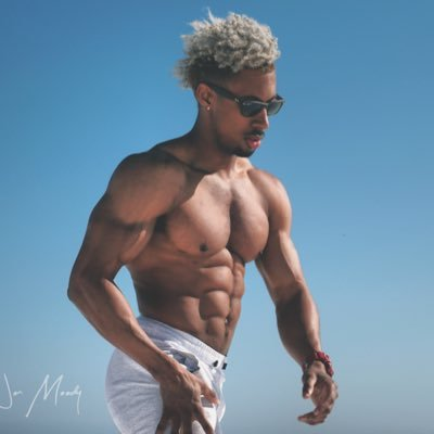 The Cancer with shirtless muscular body on the beach