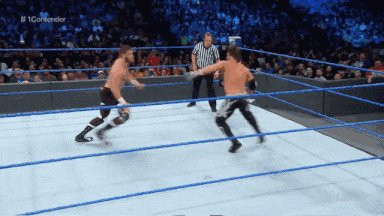 A picture perfect Blue Thunder Bomb by Sami Zayn on AJ Styles.