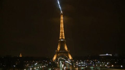 The Eiffel Tower in Paris has gone dark to pay tribute to the victims...