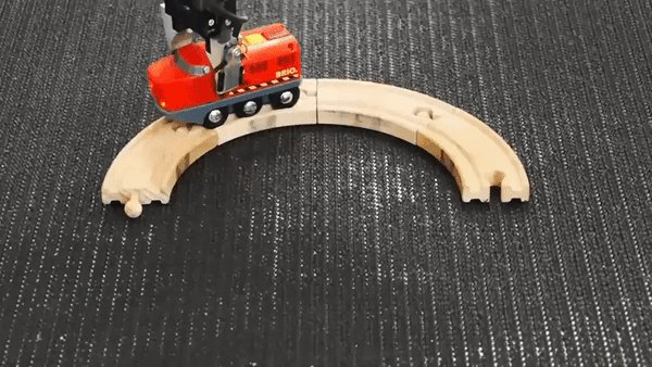 .@swissmiss Endless loop with robot and toy train.