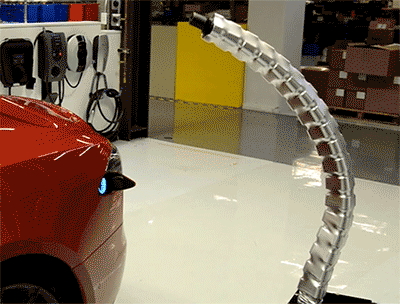 I am both engrossed and terrified by @TeslaMotors' robo-charger http://t.co/8QPP0CISP3 http://t.co/LzWZG5AvlH