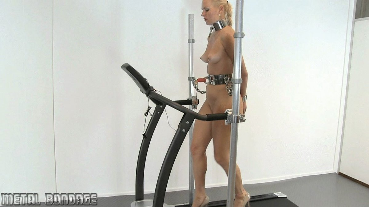 Sexy beautiful fit and toned woman walking on the treadmill