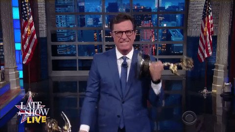 Stephen Colbert fits in some bicep curls while commenting about Donald Trump's lack of Emmys